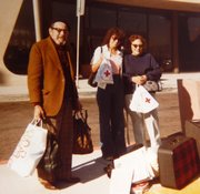 Ralph Morris, Joyce Axilrod, and Ruth Morris with bags from the American Red Cross after the fire.