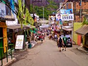 Via pia, the main commercial street rising from the main entrance to Rocinha, is devoid of its usual dense Friday afternoon bustle.