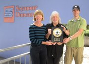 Cathy Carter Duncan and Seymour Duncan receive an award from Notes for Notes for their support.