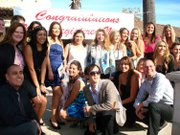 SBCC President Andreea Serban (center, print jacket) celebrates with SBCC students who earned their Associate in Science Nursing degrees on December 11.