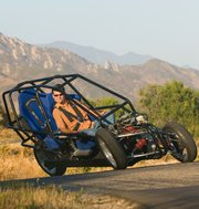 Ben Werner of Revolution Motors drives Dagne