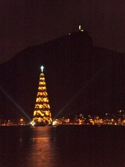 An 85m tall cone of lights offers a Christmas light show in the middle of Rio's picturesque lagoon.
