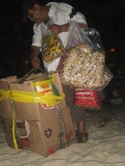 A ubiquitous beach vendor works even on Réveillon.