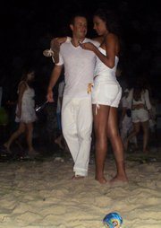 This couple adds to the sea of 2 million white-clad Réveillon celebrators on Copacabana Beach.