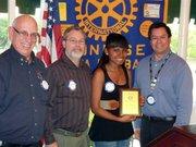 Rotary President Bill Boyd; Michael Riley, El Puente teacher; Koraima Hernandez, Student of the Month; and David Velarde, Rotary Member.