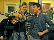 Marz Miller, right, takes a break from shooting with crew members Diego Rodriguez (left) and Matt Burns (center).