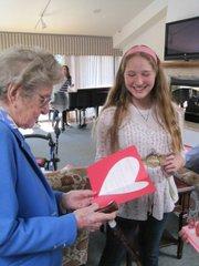 Resident Margaret Hurley gets a valentine from Julia Pilkington
