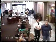 Security cameras show that after David Cohen was stopped by guards, he was quickly surrounded by three of them (above).