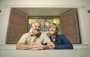 "Doug and Marian McKenzie at home in Montecito framed by a window curtained from Bettina Hubby's ""Hubby Moves In."""