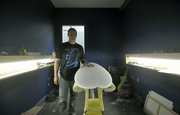 J7 surf shop owner Jason Feist in the shaping room at his new location on Mason Street in the heart of Santa Barbara's Funk Zone.