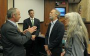 Tony Vegel, Geoff Miller, Marc Chytilo, and Lauren McElroy talk after the NRC meeting at the Santa Barbara County Supervisors June 16, 2011