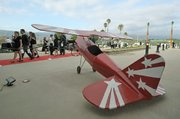 A large model plane by the red carpet welcoming to the Santa Barbara Airport remodel grand opening June 17, 2011