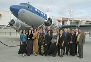 """Local dignitaries, politicians and airport employees pose in front of a vintage DC-3 United """"Mainliner"""" airplane at the Santa Barbara Airport remodel grand opening celebration  June 17, 2011"""