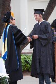 SBCC Continuing Education Vice President Dr. Ofelia Arellano congratulates Gabriel Neustadt upon his graduation.