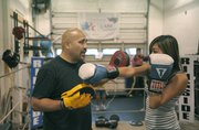 13 year-old Leydi Cortes, who has been coming to Primo for two years, works with Joe in the ring