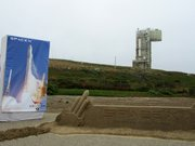 Groundbreaking of Falcon Heavy launch pad at Vandenberg Air Force Base. Titan IV launch tower in background.