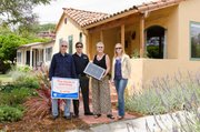 Susan Powell and her husband with an REC Solar representative and Megan Birney from the CEC.