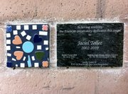 Mosaic made by Jaciel Tellez with a memorial plaque