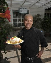 Garden Market Executive Chef Natividad Marquez with a bowl of Pozole Verde.