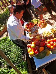 "Chef Gregg Wangard of Marisol at the Cliffs Resort prepares bruschetta in the garden to help celebrate ""Ode to Tomatoes."""