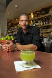 "The Hungry Cat bartender/server Shaun Belway with a ""Magic Elixer"""