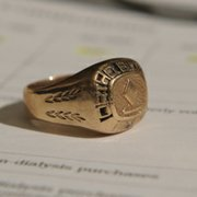 Signet ring received by Mark Duxbury from Johnson & Johnson as a reward for selling $1.6 million worth of Procrit.