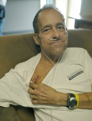 "William ""Kickstand"" Armstrong shows off the scar from his pacemaker surgery."