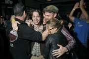 Saint Anne's Place gets hugs from fans after being named the winner in the 2011 Downtown Sound battle of the bands at SOhO