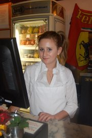 This is 8th grader Hannah Montgomery-Kriegler behind the counter at Via Maestra Resturant in 2010.