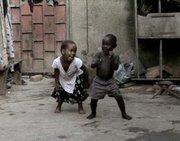 Two kids dancing in Uganda.