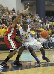 UCSB's James Nunnally (21), driving on UNLV's Anthony Marshall.