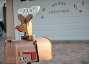 Neighbors on the 6100 block of Manzanillo Drive decorate their mailboxes with the same wooden reindeer head.