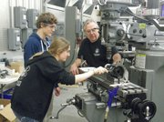 Sophie D'Arcy and Mark Beers working with machine shop mentor, Terry Hart