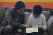 Tutors are on hand to help kids stay abreast of their studies.