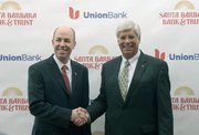 Tim Wennes, vice chairman of Union Bank (left) and George Leis, President and COO of Santa Barbara Bank &amp; Trust