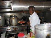 Babatunde as chef, hosting his election night party in 2001 at Pascucci's.