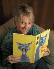 Lee Wardlaw at her home in Santa Barbara with a copy of Won Ton: A Cat Tale Told in Haiku April 6, 2012