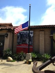 The American flag in front of the Santa Barbara Historical Museum flies at half-mast after David Bisol's passing