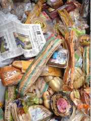 Trader Joe's food items found in Whole Foods trash dumpster. (Copy of daily newspaper included to prove date of discovery.)