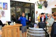 Ernst Storm explains winemaking to Elderhostel's Road Scholars at Curtis Winery last Thursday.
