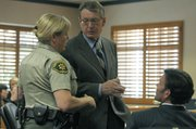 Chet Taylor is lead out of the courtroom by a bailiff