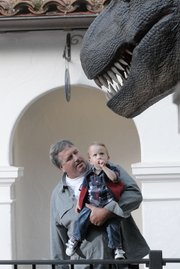 2-year-old Jake Wyatt  checks out the T. rex with Dad Cliff.