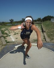 """Stamatia Scarvelis, a 16-year-old sophomore at Dos Pueblos High, came through on her final attempt to win the girls' shot put at the CIF State Track and Field Championships last Saturday in Clovis. Scarvelis was in fourth place before she uncorked a heave of 14.40 meters (47'3 ¼""""), surpassing the runner-up mark of La Sierra High junior Tanya Sapa by three centimeters. There is gender equity in the Scarvelis family – Stamatia's brother, Nicholas, won the boys' state shot put title last year as a Dos Pueblos senior."""