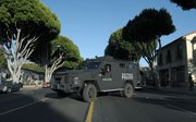 The SBPD's Bearcat armored vehicle responds to reports of a woman with a handgun barricaded inside her Milpas Street apartment