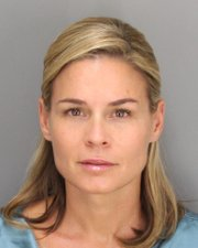 Cat Cora booking photo (June 28, 2012)