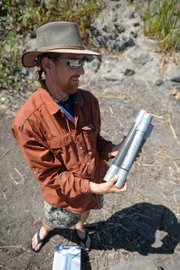 Kevin Schmidt of the U.S. Geological Survey holds Lake Los Carneros core samples.