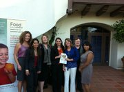 (From left to right) Danielle De Smeth, Gabriela Ferreira, Emily Allen, Brandi Redman, Angela Roach, Laura Dewey, all members of Santa Barbara Women Lawyers; and Eloisa Chavez, Community Programs Coordinator for the Foodbank of Santa Barbara County, celebrate the success of the Food from the Bar fundraising campaign.