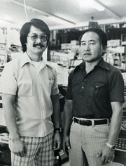Dennis Tokumaru stands with Isla Vista Bookstore&#39;s founder John Sakurai