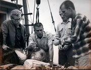 "Hugh ""Dan"" Wilson (right) briefing safety divers during pre-dive planning aboard the fishing vessel Rio Janeiro, November 3, 1962"