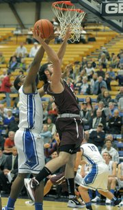 UCSB&#39;s &quot;Big&quot; Al Williams blocks Westmont&#39;s Marcus Farrand&#39;s layup. 
